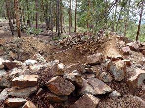 strange hole dug by trail
