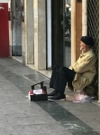 people sold cigarettes on the sidewalk